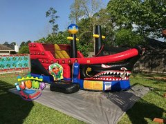 Neverland Pirate Combo bounce house area with slideRecommended for ages 7 and under Space Needed: 27'L x 18'W x 21'H