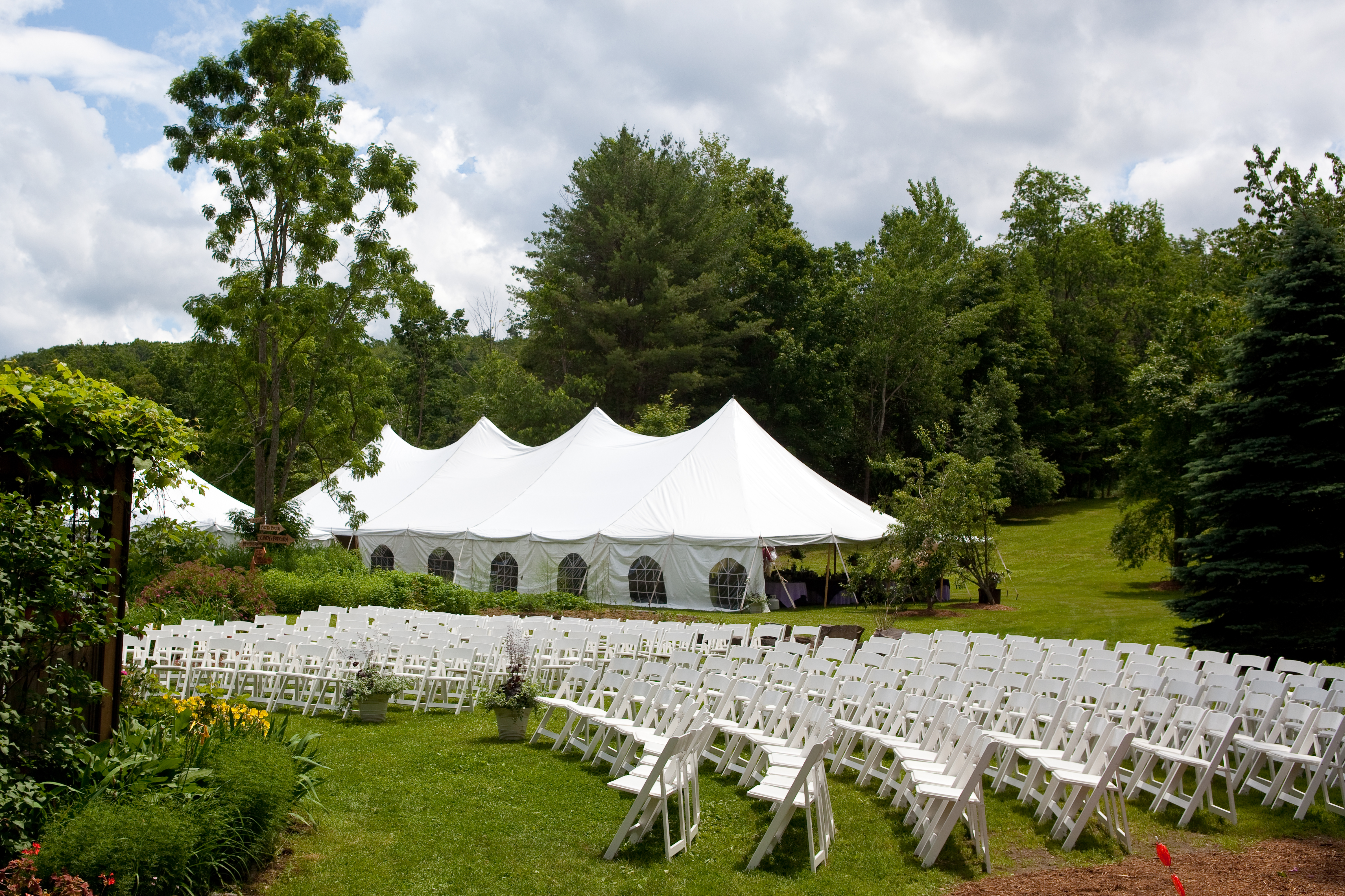 40X100 pole tent with ceremony chairs