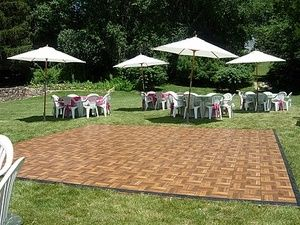 Dance floor with round tables and umbrellas