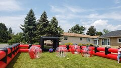 Package 2- 90 Minute Event Rental, includes 8 balls, sizes vary, inflatable field, foot darts, corn hole, hula hoops, connect four tax included