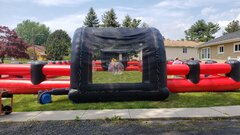Package 4- 90 Minute Event Rental, includes 12 balls, sizes vary, inflatable field, foot darts, corn hole, hula hoops, connect four tax included