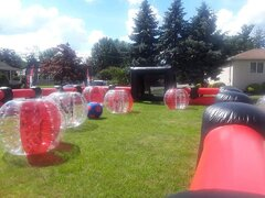 Package 1- 90 Minute Event Rental, includes 6 balls, sizes vary, inflatable field, foot darts, corn hole, hula hoops, connect four tax included