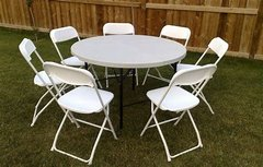 (4) round tables & 25 folding chairs