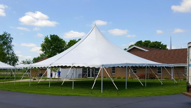 40' X 40' (1,600  square feet) Pole Tent on grass (Walls can be added, but are not included)