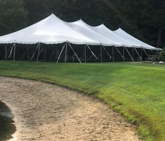 40' X 100' (4,000 Square Feet) Pole Tent on grass