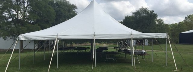 30' X 40' (1,200 square feet) Pole Tent on grass