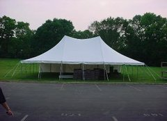20' X 30' (600 Square Feet) Pole Tent on grass (Walls can be added, but are not included)