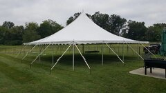 30' X 30' (900 Square Feet) Pole Tent on grass (Walls can be added, but are not included)