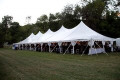 40' X 120' (4,800 Square Feet) Pole Tent on grass (Walls can be added, but are not included)