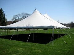 40' X 60' (2,400 square feet) Pole Tent on grass (Walls can be added, but are not included)