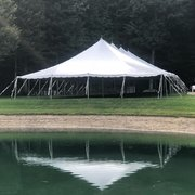 40' X 80' (3,200 square feet) Pole Tent on grass (Walls can be added, but are not included)