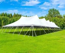 60' X 130' (7,800 Square Feet) Pole Tent on grass (Walls can be added, but are not included)