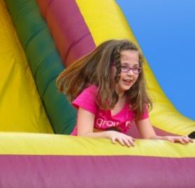 young girl in bounce slide