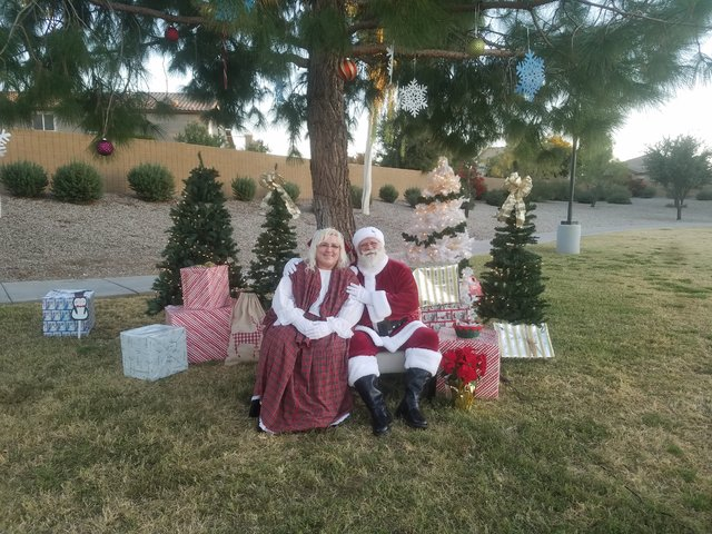 rad Santa Michael and mrs claus