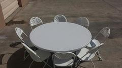 Set 60in Round Table and 8 White Chairs
