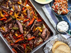 Catering: Fajitas - Beef and Chicken Fajitas - Flour + Corn tortillas, Mexican rice and beans, salsa verde, salsa rojo, Our Famous chips, lettuce, cheese, Sour Cream, Homemade Guacamole,- 40 Person Min. Per Person Charge