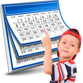 Boy pointing to a calender