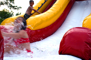 Girl sliding down a water slide