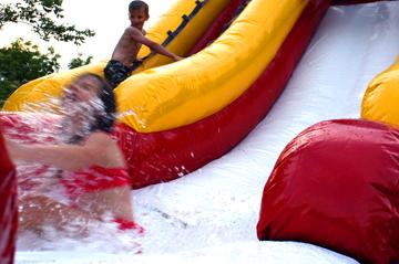 girl sliding down water slide