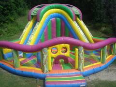Inflatable Funland w/ giant slide and bounce area..